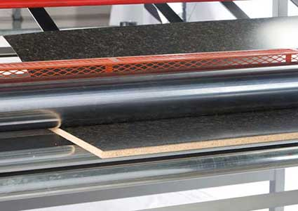 your material sample being bonded on the Advantage Laminiating System